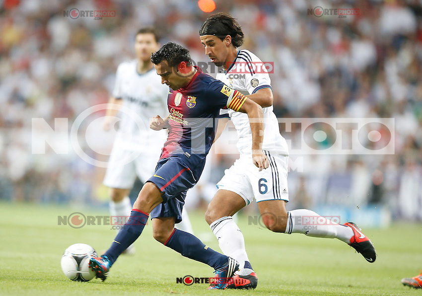 Real Madrid's Sami Khedira against Barcelona's Xavi Hernandez during Super Cup match. August 29, 2012. (ALTERPHOTOS/Alvaro Hernandez). NortePhoto.com