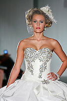 Model walks the runway in an Alexandra wedding dress by Katerina Bocci during the Wedding Trendspot Spring 2011 Press Fashion, October 17, 2010.