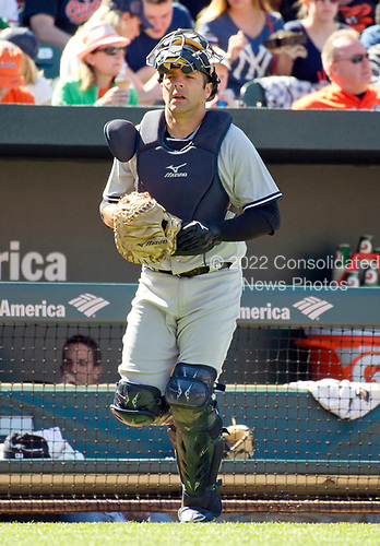 New York Yankees catcher Austin Romine (27) walks towards his position behind home plate as he comes out for the bottom of the sixth inning of the game against the Baltimore Orioles at Oriole Park at Camden Yards in Baltimore, MD on Sunday, April 9, 2017.  The Yankees won the game 7 - 3. <br /> Credit: Ron Sachs / CNP<br /> (RESTRICTION: NO New York or New Jersey Newspapers or newspapers within a 75 mile radius of New York City)