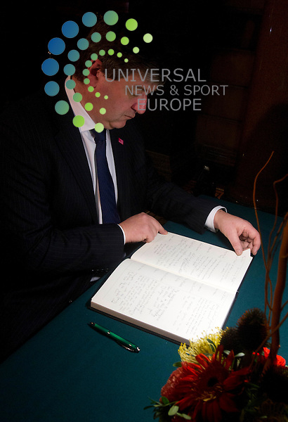 Secretary of State for Scotland Alistair Carmichael signs a book of condolence for the Clutha bar victims at the City Chambers in Glasgow. <br /> Picture: Maurice McDonald/Universal News And Sport (Europe) 2 December  2013