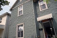 1995 May ..Conservation.Lamberts Point...Slum Conditions.Exterior Front. crippled elderly woman in doorway.3711 Bowden Ferry Road...NEG#.NRHA#..CONSERV: Lambert2 6:8