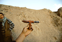 A home made gun in Bamiyan. .Plumbery, rubber band and a 7.62 x 39 mm Kalashnikov bullet...