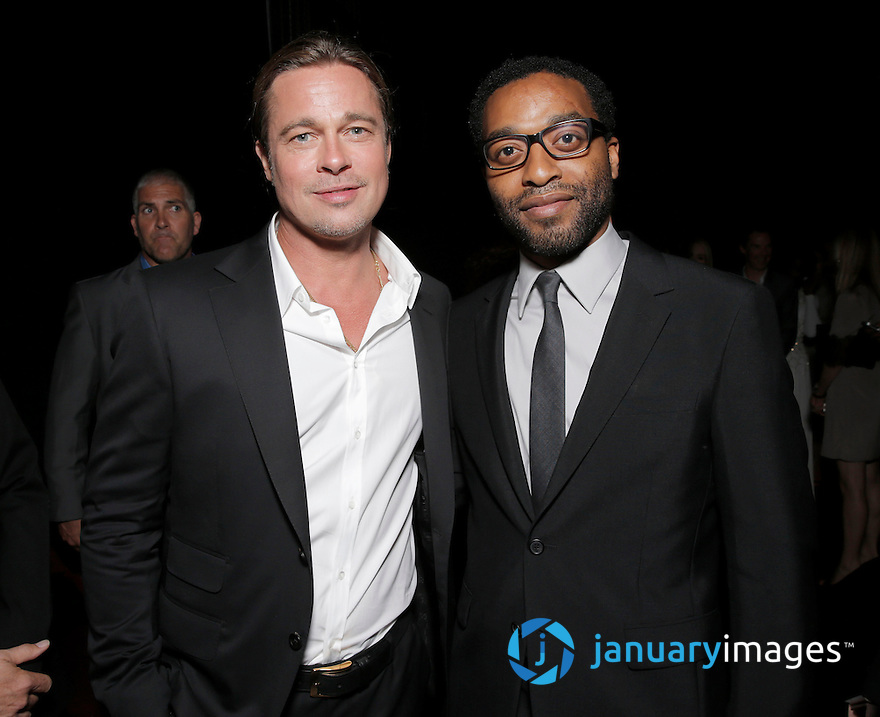 """Brad Pitt and Chiwetel Ejiofor are seen at Fox Searchlight's Premiere of """"12 Years A Slave"""", on Friday, September 6th, 2013 in Toronto, Canada. (Photo by Todd Williamson/Invision for Fox Searchlight/AP Images)"""