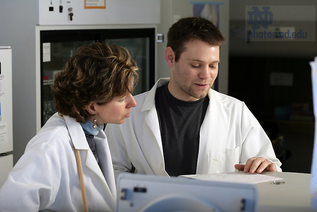 Prof. Nora Besansky with grad student Brad White in her lab in Galvin Hall on the campus of the University of Notre Dame
