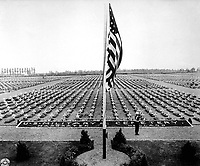 A bugler blow taps at the close of Memorial Day service at Margraten Cemetery, Holland, where lie thousands of American heroes of World War II.  May 30, 1945.  Pfc. Richard G. Thompson.  (Army)<br /> NARA FILE #:  111-SC-207902<br /> WAR &amp; CONFLICT BOOK #:  1348