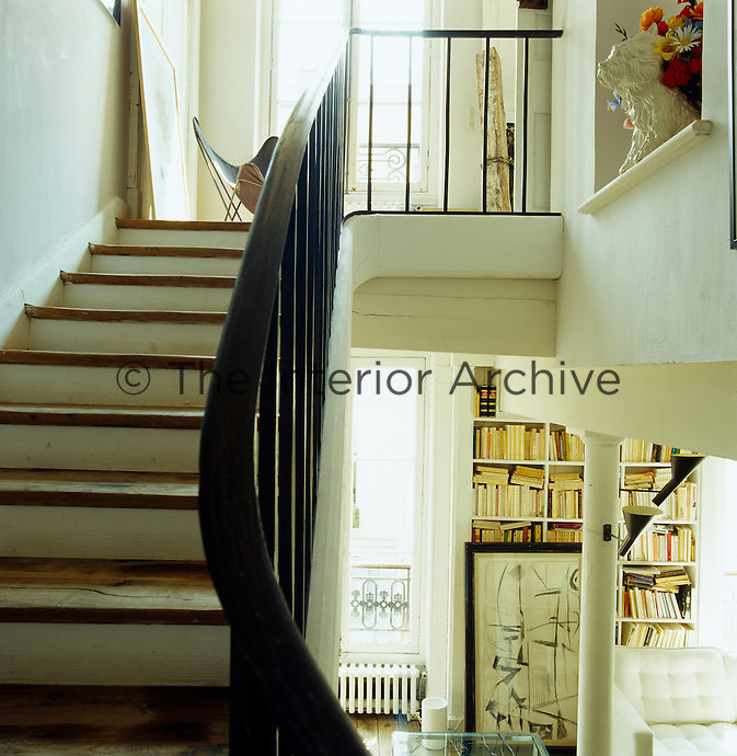 View looking up the staircase leading from the library to the first floor