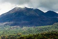 Java, East Java, Batu. Steaming volcano and forest west of Batu.