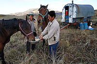 Antonio Basualdo Solorzaho and Modesto Tacza Martinez fed the bronco as they say in Spanish--or mustang.  Modesto then saddled and rode off on the former wild horse to find the sheep.<br />