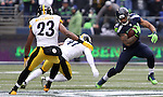 Seattle Seahawks running back Thomas Rawls (34) eludes Pittsburgh Steelers cornerback Antwon Blake (41) and safety Mike Mitchell (23) at CenturyLink Field in Seattle, Washington on November 29, 2015.  The Seahawks beat the Steelers 39-30.      ©2015. Jim Bryant Photo. All Rights Reserved.