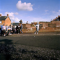 Republican youths in the Nationalist / Republican Ardoyne area of Belfast attack police in an attempt to disrupt a loyalist band marching past their estate during the annual July 12th parades. The yearly marching season often sparks trouble between Protestant and Catholic communities living in close proximity to each other. It is held to commemorate the victory of Protestant king.William III over the Catholic king James in 1690. For.many it remains a focal point in the Protestant.calendar. .