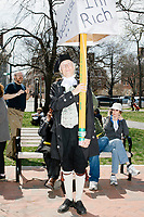 A man dressed as an American revolution-era Minuteman stands in Cambridge Common for a Tax Day protest near Harvard Square in Cambridge, Mass., on Sat., April 15, 2017. The demonstrators called for President Donald Trump to release his tax returns. Trump refused to release his tax returns during the 2016 presidential campaign, in contrast to all previous major party presidential candidates, and continues to refuse to release them. The protest was part of a larger movement nationwide called Tax March.