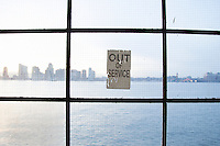 out of service sign posted on a window overlooking New Jersey