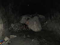 Pictures taken inside the San Jose mine in Chile where 33 miners were trapped for 69 days. The pictures were taken by and of Edison Pena before the miners were rescued. Edison Pena went on to become the 12th miner to be freed and the first to return home from hospital...Edison Pena posing for a picture.