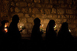 Greek-Orthodox Christian nuns walk along Via Dolorosa in Jerusalem's old city, during a procession commemorating the death and the resurrection of Saint Maria.