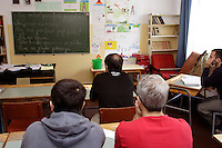 Chechen men and boys learning Polish in a classroom in the URiC Wola Refugee Centre in Poland..-For security reason, the face of the adult asylum seeker have been evicted of the photography..-For security reason, the names of the adult asylum seeker have been change. .-Article 9 of the Act of 13 June 2003 on grating protection on the Polish territory (Journal of Laws, No 128, it. 1176) personal data of refugees are an object of particular protection..-Cases where publication of a picture or name of asylum seeker had dramatic consequences for this persons and is family back in Chechnya. .Please have safety of those people in mind. Thank you.