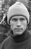 portrait of a young and handsome fisherman in a wool hat and turtleneck sweater