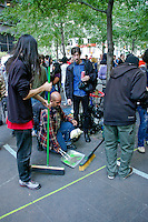 Protesters keep Zuccotti Park clean during the Occupy Wall Street Protest in New York City October 6, 2011.