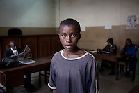 16 Abdul Sesay waits for his trial in court. He is on remand in Pademba Central Prison accused of theft of a radio.