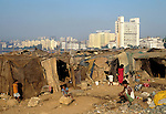 Slum shanty housing with affluent suburb of Bandra behind..