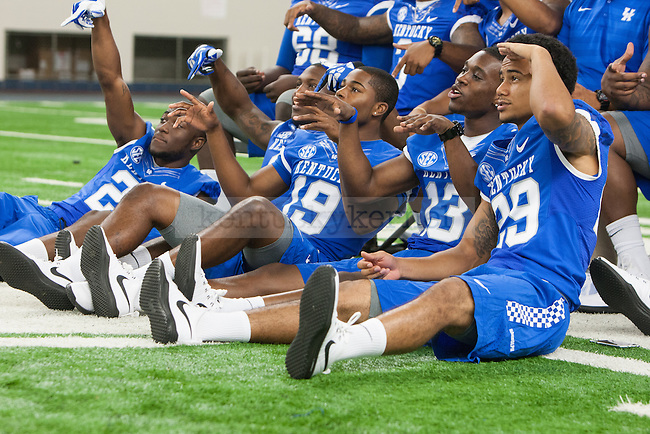 Players pose for a photo during UK football media day at Nutter Field House in Lexington, Ky., on Friday, August 8, 2014. Photo by Adam Pennavaria | Staff
