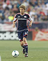 New England Revolution midfielder Scott Caldwell (6) brings the ball forward.  In a Major League Soccer (MLS) match, the New England Revolution (blue) tied D.C. United (white), 0-0, at Gillette Stadium on June 8, 2013.