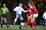 24 November 2013: Duke's Kaitlyn Kerr (5) and Arkansas' Hailey Pescatore (3). The University of Arkansas Razorbacks played the Duke University Blue Devils at Koskinen Stadium in Durham, NC in a 2013 NCAA Division I Women's Soccer Tournament Third Round match. Duke advanced by winning the penalty kick shootout 5-3 after the game ended in a 2-2 tie after overtime.