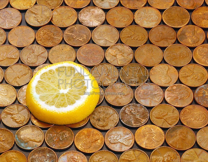 LEMON REMOVES TARNISH FROM COPPER PENNIES<br /> (1 of 2)<br /> Citric Acid and Copper Oxide<br /> A slice of lemon is placed on a bed of tarnished copper pennies.