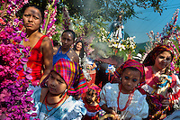 "Salvadoran girls and women carry an altar with a statue of Virgin Mary during the procession of the Flower & Palm Festival in Panchimalco, El Salvador, 8 May 2011. On the first Sunday of May, the small town of Panchimalco, lying close to San Salvador, celebrates its two patron saints with a spectacular festivity, known as ""Fiesta de las Flores y Palmas"". The origin of this event comes from pre-Columbian Maya culture and used to commemorate the start of the rainy season. Women strip the palm branches and skewer flower blooms on them to create large colorful decoration. In the afternoon procession, lead by a male dance group performing a religious dance-drama inspired by the Spanish Reconquest, large altars adorned with flowers are slowly carried by women, dressed in typical costumes, through the steep streets of the town."