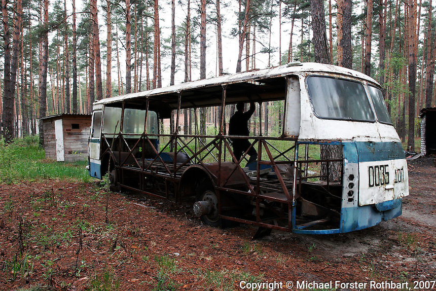 Photo title:.Abandoned bus in Lyutezh..Caption:.Many vehicles used for evacuation and decontamination were too radioactive to keep using after the Chernobyl accident. Trucks, busses and contaminated equipment were buried in over 800 dumpsites, mostly unmarked. Other machinery was simply abandoned. These have since been stripped of any salable parts by scrap metal dealers...Outside the restricted Exclusion Zone are 2,293 small villages in Ukraine where the land was slightly contaminated by radioactive fallout. Those who still live here receive very little information about possible health risks. Many receive small government pensions for their status as Chernobyl survivors...Quote: none.-------------------.This photograph is part of Michael Forster Rothbart's After Chernobyl documentary photography project..© Michael Forster Rothbart 2007-2010..www.afterchernobyl.com.www.mfrphoto.com o 607-267-4893 o 347-722-0479.20 Gardner Place, #59, Oneonta, NY 13820.86 Three Mile Pond Rd, Vassalboro, ME 04989.info@mfrphoto.com.Photo by: Michael Forster Rothbart.Date:  5/2007    File#:  Canon 20D digital camera frame 6582