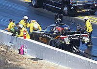 Jul 31, 2016; Sonoma, CA, USA; NHRA safe safari rescue crews tend to funny car driver Alexis DeJoria after hitting the wall during the Sonoma Nationals at Sonoma Raceway. DeJoria was transported to a local hospital after complaining of back pain. Mandatory Credit: Mark J. Rebilas-USA TODAY Sports