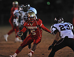 Lafayette High's Demarkous Dennis (5) runs vs. Greenwood High in MHSAA playoff action in Oxford, Miss. on Friday, November 11, 2011. Lafayette High won 53-8.