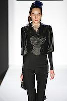 Lolita walks runway in a bebeBlack Fall 2011 outfit, at the Style 360 Fall 2011 fashion show, during New York Fashion Week.