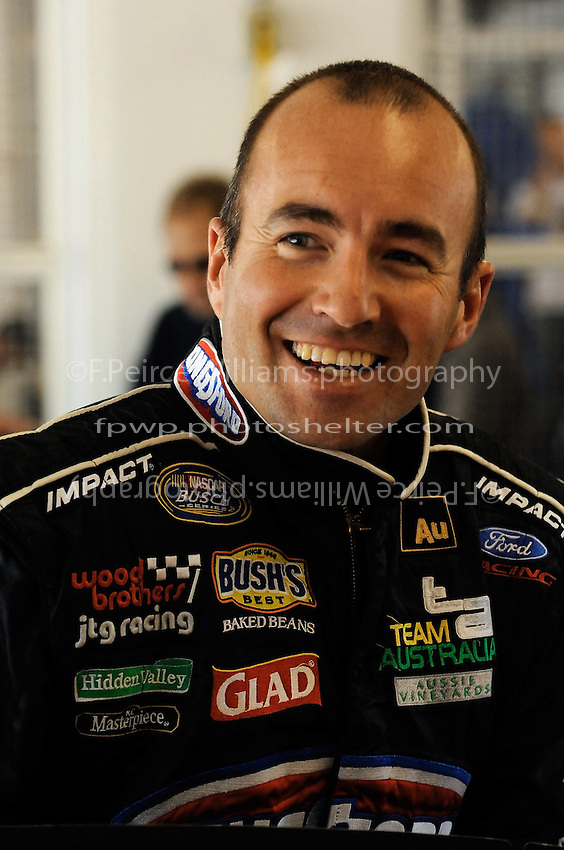04/18/08 Mexico City .Marcos Ambrose is all smiles as he climbs into his Ford Fusion for practice.