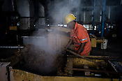 A factory worker is seen working at at the Sipef oil mill in Sumatra, Indonesia.