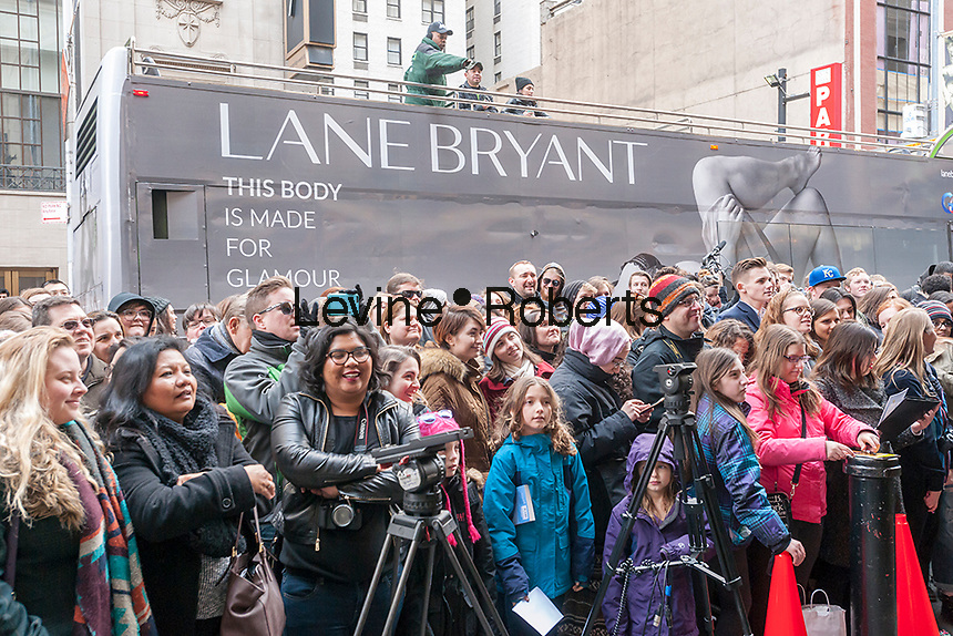 """Hundreds of theater lovers in front of the Richard Rodgers Theatre in Times Square in New York on Wednesday, April 6, 2016 for a chance to win one of 22 tickets in the #Ham4Ham lottery for seats for the Broadway blockbuster """"Hamilton"""". The $10 live lottery takes place in front of the theater for the Wednesday matinee performance while for the rest of the week's performances the lottery is online. (© Richard B. Levine)"""