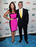 Lisa Vanderpump, Andy Cohen.Bravo's Andy Cohen's Book Release Party For &quot;Most Talkative: Stories From The Front Lines Of Pop Held at SUR Lounge, West Hollywood, California, USA..May 14th, 2012.full length black dress pink suit yellow tie hand on hip.CAP/ADM/KB.&copy;Kevan Brooks/AdMedia/Capital Pictures.
