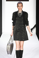 Alex walks runway in a bebeBlack Fall 2011 outfit, at the Style 360 Fall 2011 fashion show, during New York Fashion Week.