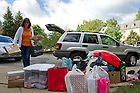 August 17, 2012; Mary Stankowicz of Chicago, unloads her daughter's belongings at Pasquerilla Hall West during move in day.  Photo by Barbara Johnston/University of Notre Dame