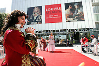 Louis XIV, played by Bryan Mercer, and other members of the French-language troupe Théâtre du Rêve entertain people during the pubic opening of Louvre Atlanta at the High Museum of Art. Over the next three years, the High Museum will feature hundreds of works of art from the Musée du Louvre in Paris.