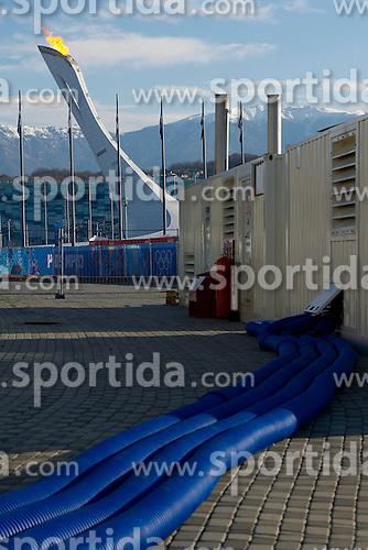 14.02.2014, Olympic Park, Adler, RUS, Sochi, 2014, Feature, im Bild Freiligende Leitungen vor dem Olympschen Feuer // during the Olympic Winter Games Sochi 2014 at the Olympic Park in Adler, Russia on 2014/02/14. EXPA Pictures &copy; 2014, PhotoCredit: EXPA/ Freshfocus/ Urs Lindt<br /> <br /> *****ATTENTION - for AUT, SLO, CRO, SRB, BIH, MAZ only*****