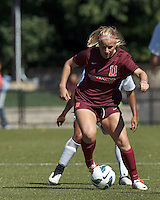 Virginia Tech forward Katie DeTuro (11) dribbles.Virginia Tech (maroon) defeated Boston College (white), 1-0, at Newton Soccer Field, on September 22, 2013.