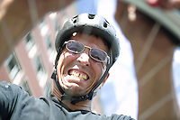 2 July 2005 - Jersey City, NJ, USA - A rider struggles to change a tyre - a required exercise - in a qualifying race for the 13th annual cycle messenger world championships, Jersey City, USA, July 2nd 2005. More than 700 riders from all over the world took part in the 4-day competition which carries event based on the daily work of a city bike messenger.