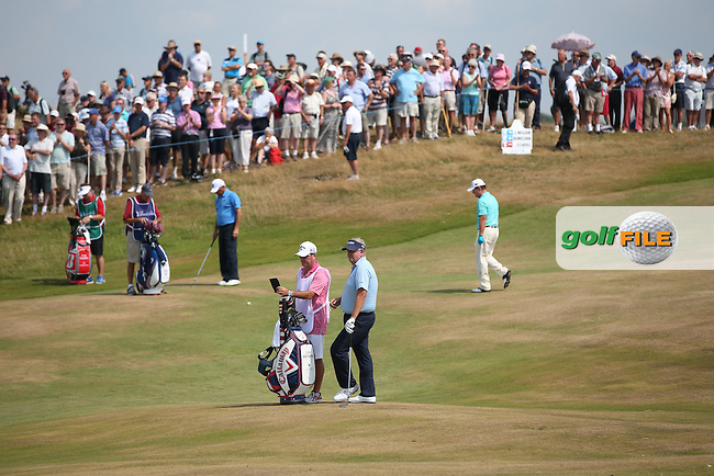 Tom Watson (USA) watched by a large Welsh crowd during Round Two of the 2014 Senior Open Championship presented by Rolex from Royal Porthcawl Golf Club, Porthcawl, Wales. Picture:  David Lloyd / www.golffile.ie