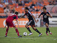 Dwayne De Rosario (7) of D.C. United tries to get a shot past Gonzalo Segares (13) of the Chicago Fire at RFK Stadium in Washington, DC.  D.C. United defeated the Chicago Fire, 4-2.