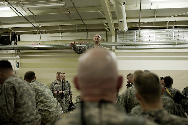 April 16, 2009. Pope Air Force Base, NC.. Members of the North Carolina National Guard's 30th Brigade Heavy Combat Team leave Pope Air Force Base for a 12 month tour in Iraq. In all, approximately 4,000 soldiers from the 30th HBCT are deploying and this will be the Brigade's 2nd deployment since 2003.. An officer gathers his soldiers to board the plane.