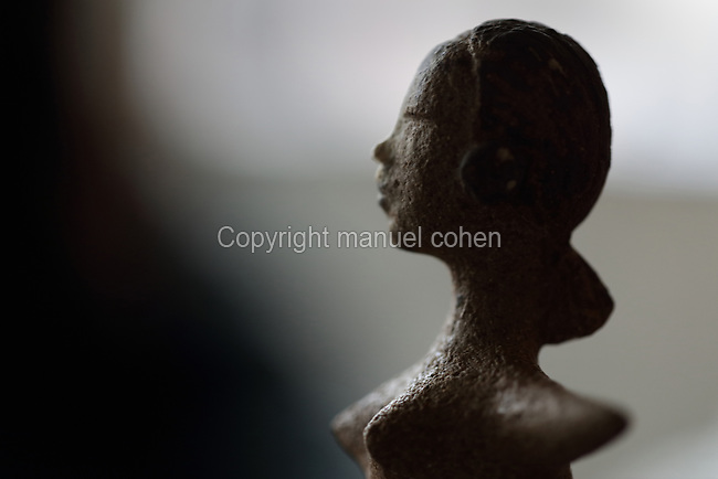 A female figurine by ceramicist Valeria Polsinelli, created in her studio in Montreuil, a suburb of Paris, France. Polsinelli creates everyday vessels, water jugs, jewellery and figurines and stoppers of female busts, with features and hairstyles from various world cultures. Picture by Manuel Cohen