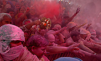 Devotees smeared with gulal (powdered colour) inside the temple of Radha (Radhika) in Barsana, Uttar Pradesh, India on the day of Lathmar holi. Lathmar holy is celibrated 7 days before the actual holi day.