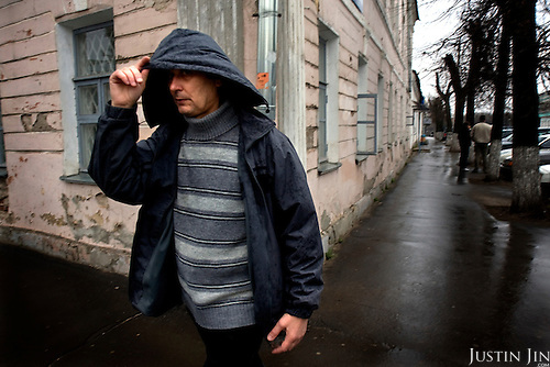 People walk on a delapidated street in the town of Tver, between Moscow and St Petersburg.