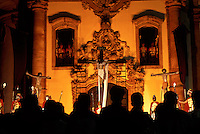 Towering crosses -- one hung with an antique statue of Jesus -- stand over a crowd in front of Ouro Prêto's historic Church of St. Francis of Assisi. A burial procession followed sermons, music and the reenactment of the removal of Jesus from the cross on Good Friday.
