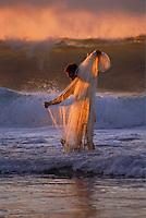 Hawaiian man with throw net at sunset